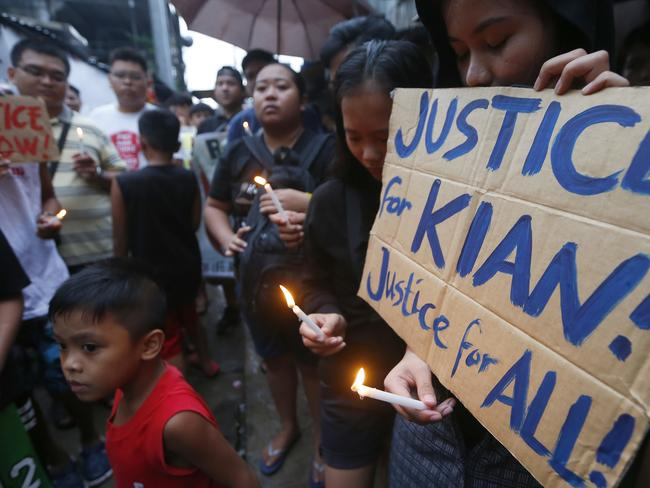 Protesters display placards in honour of a 17-year-old who was killed in a shootout with police in suburban Caloocan city north of Manila. Picture: Bullit Marquez/AP