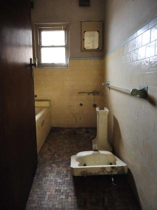 The bathroom facilities are broken and soaked in grime. Picture: Phil Rogers