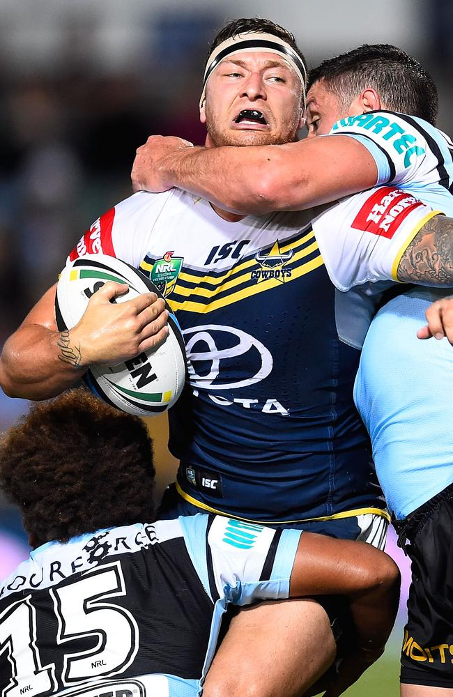 Tariq Sims of the Cowboys is tackled.