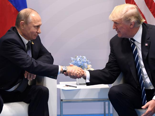 US President Donald Trump and Russia's President Vladimir Putin shake hands during a meeting on the sidelines of the G20 Summit in Hamburg, Germany. Picture: AFP