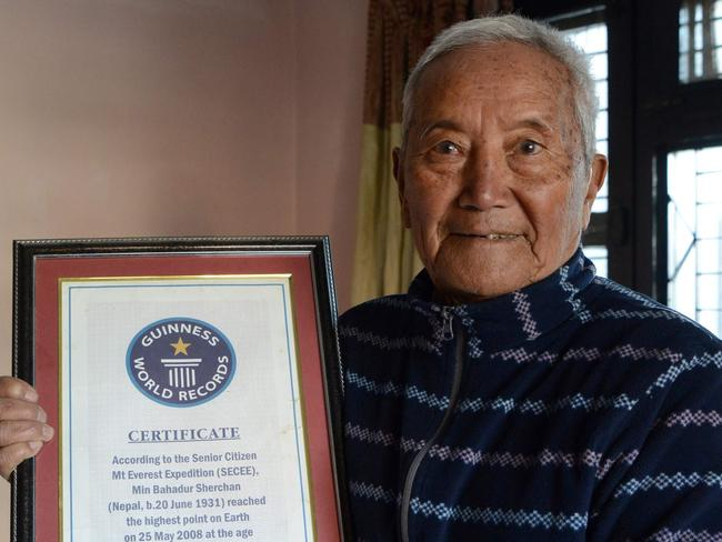 Min Bahadur Sherchan shows off his 2008 Guinness World Record certificate for being the oldest person to summit Mount Everest — a record that was later broken in 2013. Photo: AFP/Prakash Mathema