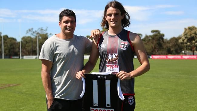 Leigh Montagna hands his No.11 to top draft pick Hunter Clark. Picture: Corey Scicluna