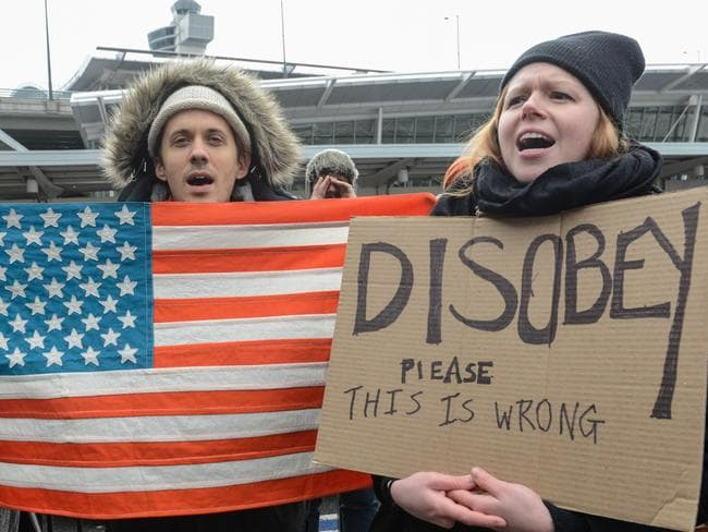 Protesters rally during a protest against the Muslim immigration ban at John F. Kennedy International Airport. Picture: Getty