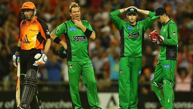 Melbourne Stars players Shane Warne, Luke Wright and Peter Handscomb react after what should have been the final ball against the Perth Scorchers is called a no-ball.