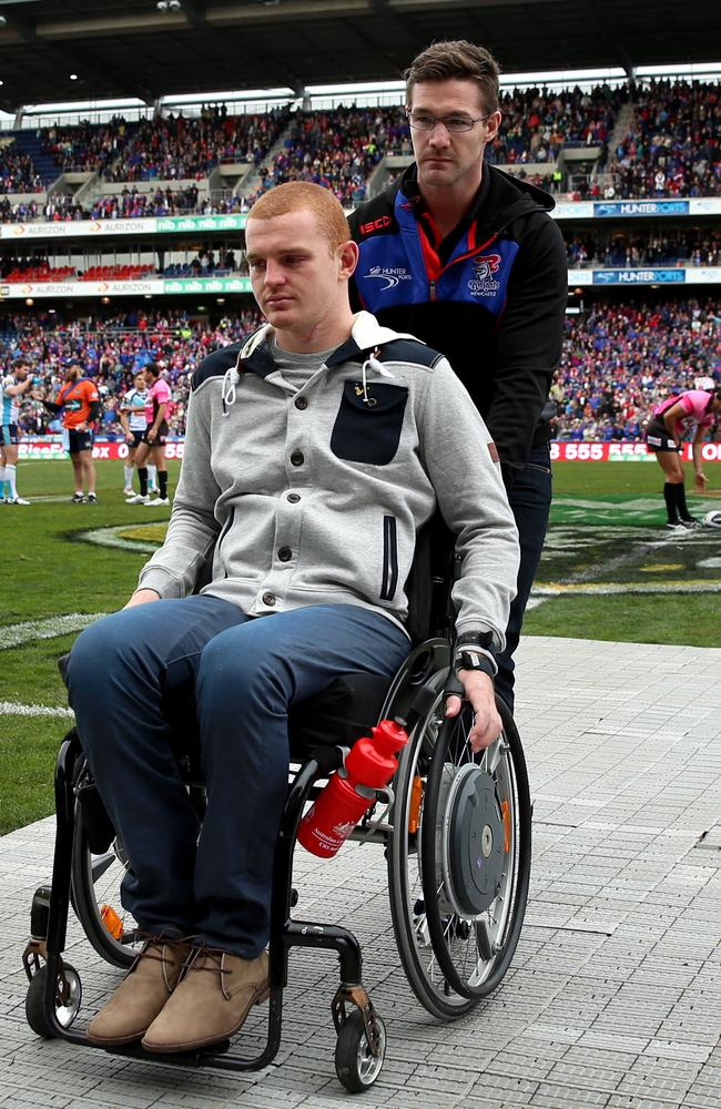 Alex McKinnon leaves the field after lining up with the teams before kick off. Pic: Gregg Porteous