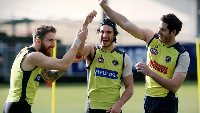 Zach Tuohy, Troy Menzel and Andrew McInnes have a laugh at Carlton training. Picture: Wayne Ludbey