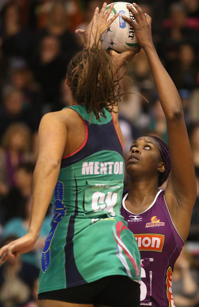 Here we go again ... Vixens' Geva Mentor defends against Romelda Aiken of the Firebirds during last year's Preliminary Final.