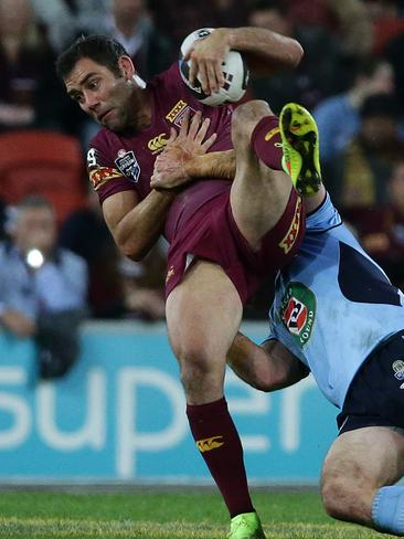 Queensland captain Cameron Smith is tackled.