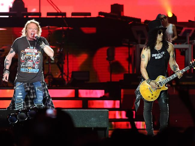 Lead singer Axl Rose (left) and guitarist Slash are back on stage together. Picture: AAP