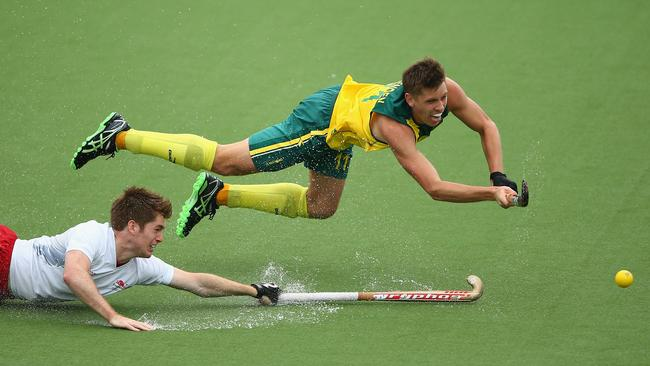 Eddie Ockenden of Australia scores the fourth goal for Australia as Henry Weir of England looks on.