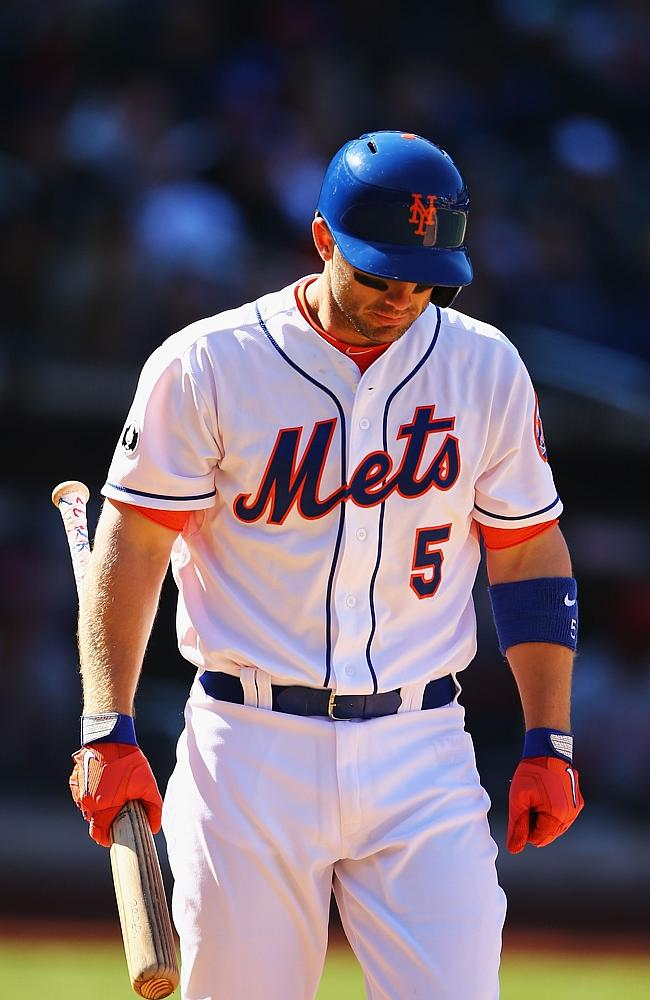 David Wright of the New York Mets walks back to the dugout after striking out against the Cincinnati Reds.
