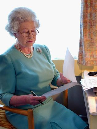 The Queen has pretty much spent most of her life reading and writing letters. Picture: Anwar Hussein/Getty Images)