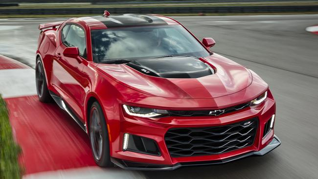 Power and glory: The Camaro, with 480kW-plus, outmuscles the rival Ford Mustang.