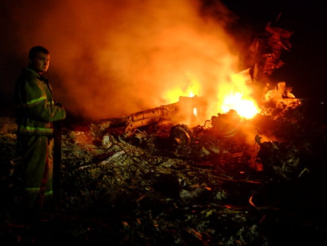First images ... some of the first shots of MH17 showed pieces of wreckage on fire. Picture: Dominique Faget / AFP / Getty Images