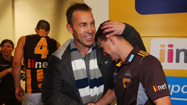 Alastair Clarkson hugs Brendon Bolton, who stood in for the coach while he was absent with a rare illness.