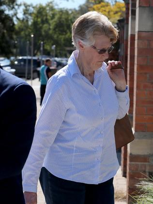 A woma believed to be the sister of Ian Turnbull enters court.