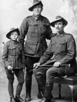 "French child refugee Henri Hemene Tovell (l) known as ""Young Digger"", mascot of Aust army number 4 Squadron during WWI with his adoptive father Tim Tovell (r) and adoptive uncle Ted Tovell (c). world war one uniform"