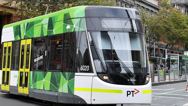An E Class tram turns into Spencer Street in Melbourne's CBD. Picture: Jake Nowakowski