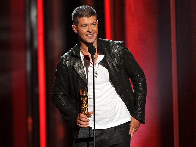 That was also then ... Thicke accepts the award for top R & B song for Blurred Lines at the Billboard Music Awards in Las Vegas. Picture: Chris Pizzello