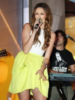 <p>Ricki-Lee Coulter performing in Pitt Street Mall today to raise money for The Smith Family charity. Picture: Justin Lloyd</p>