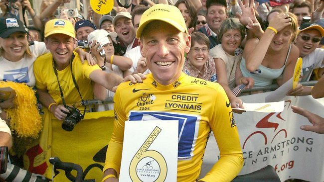 Armstrong holds a placard reading 'six' for six-straight wins of the Tour de France.