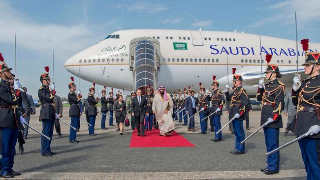 """CORRECTION - French Foreign Affairs Minister Jean-Yves Le Drian (C-L) welcomes Saudi Arabia's crown prince Prince Mohammed bin Salman (C-R) at Le Bourget airport, north of Paris, on April 8, 2018. Saudi Arabia's crown prince Prince Mohammed bin Salman arrived in France on April 8, for the next leg of a global tour aimed at reshaping his kingdom's austere image as he pursues his drive to reform the conservative petrostate. / AFP PHOTO / Saudi Royal Palace / BANDAR AL-JALOUD / RESTRICTED TO EDITORIAL USE - MANDATORY CREDIT """"AFP PHOTO / SAUDI ROYAL PALACE / BANDAR AL-JALOUD"""" - NO MARKETING - NO ADVERTISING CAMPAIGNS - DISTRIBUTED AS A SERVICE TO CLIENTS / """"The erroneous mention[s] appearing in the metadata of this handout photo by the Saudi Royal Palace has been modified in AFP systems in the following manner: [Saudi Royal Palace] instead of [Ahmed Nureldine]. Please immediately remove the erroneous mention[s] from all your online services and delete it (them) from your servers. If you have been authorized by AFP to distribute it (them) to third parties, please ensure that the same actions are carried out by them. Failure to promptly comply with these instructions will entail liability on your part for any continued or post notification usage. Therefore we thank you very much for all your attention and prompt action. We are sorry for the inconvenience this notification may cause and remain at your disposal for any further information you may require."""""""