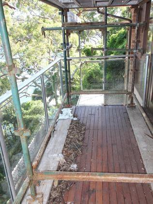 The verandah remains a worksite.