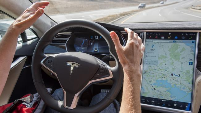 A member of the media test drives a Tesla Motors Inc. Model S car equipped with Autopilot. Picture: David Paul Morris/Bloomberg