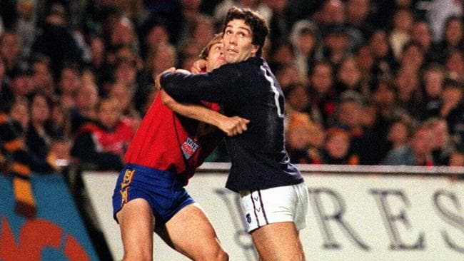 Stephen Silvagni wrestles with Tony Modra in a State of Origin match.