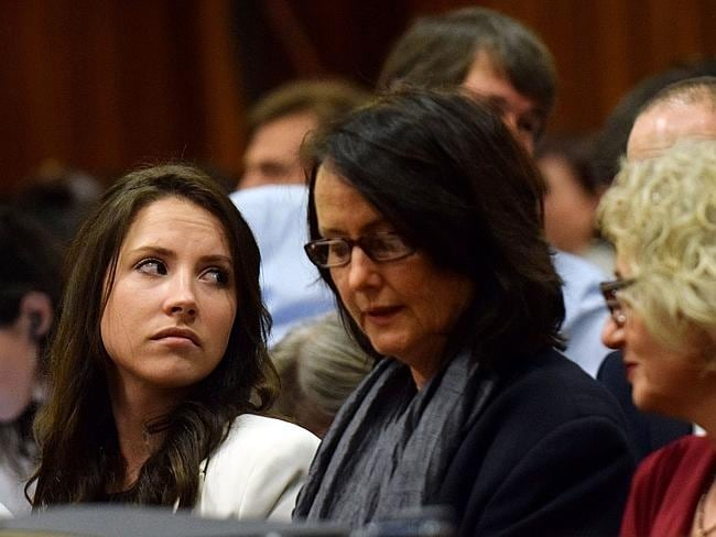 Emotional ... Oscar Pistorius' sister Aimee, left, attends his murder trial. Picture: AFP