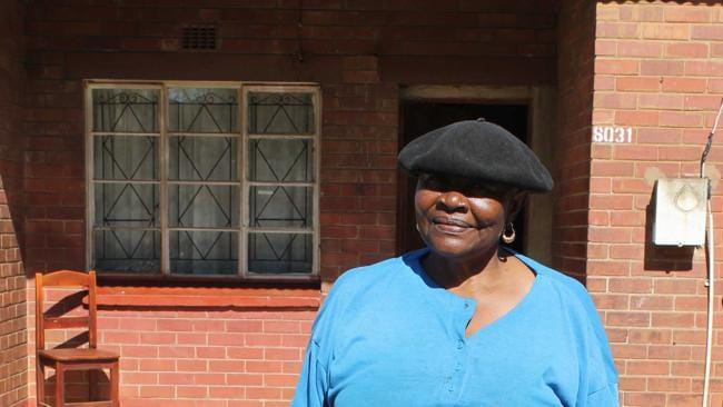 Elizabeth Queen outside her home on Vilakazi Street. The area's new-found wealth has not been popular with everyone.