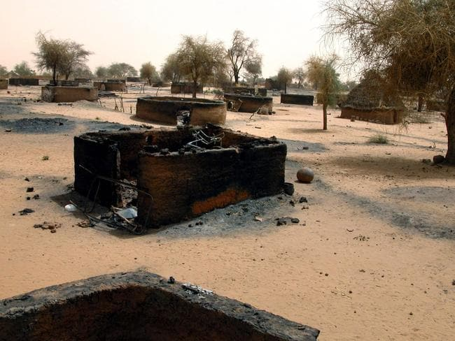 Burnt-down villages are common after years of fighting and displacement in Sudan.