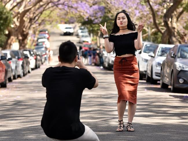 International student Manh Tran take photographs of sister Dao Tran. Picture: AAP IMAGE/Troy Snook