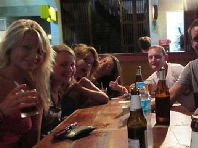 Last picture ... Hannah (left) and David (second right) with David's friend Chris Ware (third right) on the evening the pair were murdered on the Thai island of Koh Tao. The picture was taken an estimated three hours before the murder took place. Picture: AAP
