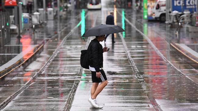 A sodden Bourke Street in Melbourne's CBD. Picture: AAP Image/James Ross.