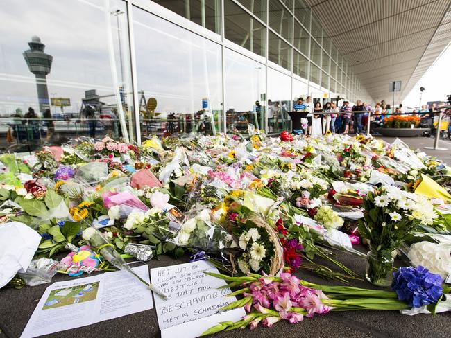 Outpouring of grief ... a sea of flowers lays at a remembrance spot at Schiphol Airport, near Amsterdam. Picture: Valerie Kuypers