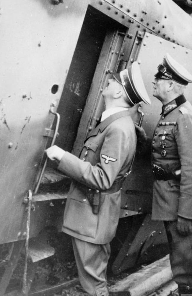 Reich machine ... Adolf Hitler inspects an armoured rail carriage during World War II. Source: IWM