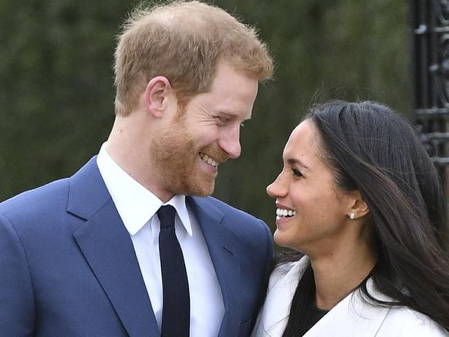 Prince Harry and Meghan Markle smile after their engagement announcement. Picture: Dominic Lipinski/PA via AP