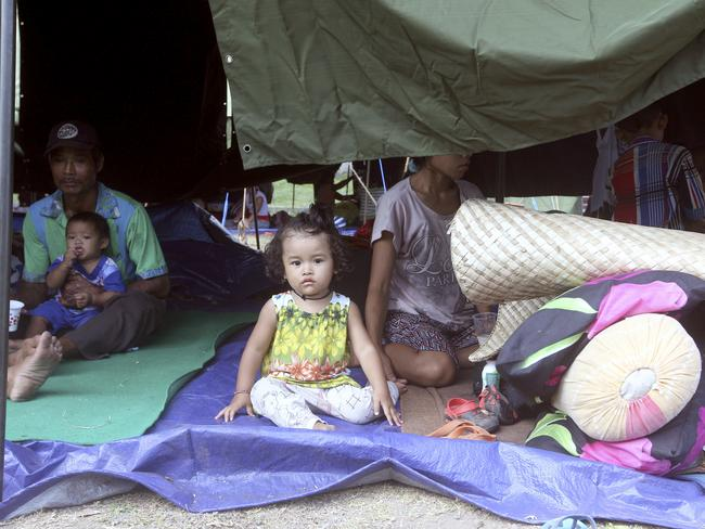 A family rest in a tent at an evacuee camp in Klungkung, Bali. More than 35,000 people have fled the menacing volcano Mount Agung. Picture: AP