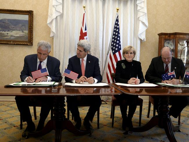 Joining forces ... U.S. Secretary of Defense Chuck Hagel, U.S. Secretary of State John Kerry and Australian Foreign Minister Julie Bishop and Defence Minister David Johnston sign a Force Posture Agreement during the Australia-US Ministerial Consultations (AUSMIN) talks Picture: AP/Dan Himbrechts