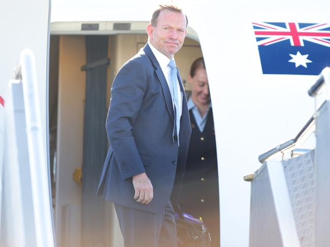In talks ... Prime Minister Tony Abbott leaves Sydney Airport bound for Indonesia. Picture Cameron Richardson
