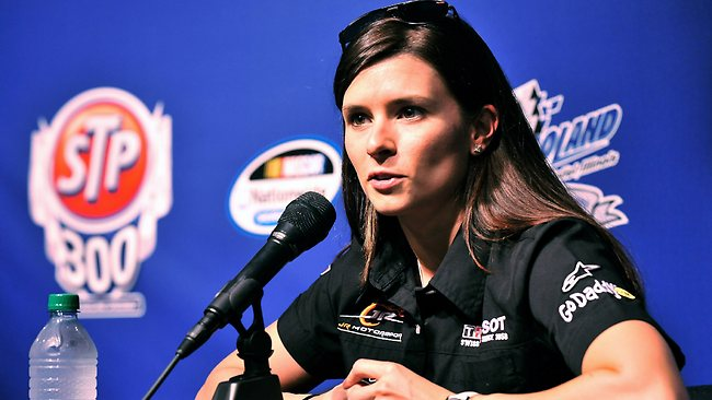 WOULD she make the grade in F1? Danica Patrick is a highly successful NASCAR driver but debate rages over whether women have a place in Formula One.