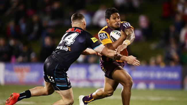 Ben Barba of the Broncos takes on the defence.