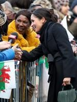 Meghan Markle talks to a member of the public as she arrives to a walkabout at Cardiff Castle on January 18, 2018 in Cardiff, Wales. Picture: Getty