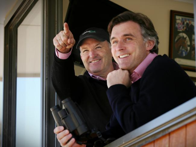 Dry argument: David Hayes and training partner Tom Dabernig oversee trackwork at Lindsay Park. Picture: Colleen Petch