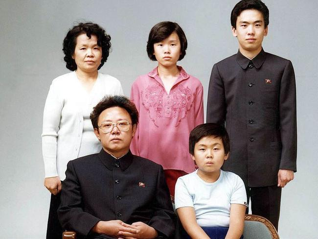 This August 1981 picture shows North Korean leader Kim Jong-il (sitting-L) sitting with his son, Jong-nam (sitting-R), Kim's sister-in-law Sung Hye-rang (L-top), Sung's daughter Lee Nam-OK (C-top) and son Lee Il-nam (R-top). North Korean leader Kim Jong-il died on December 17, 2011.