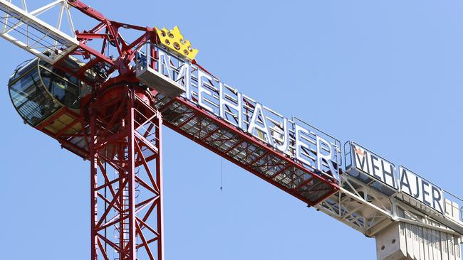The Mehajer name on cranes towering over Lidcombe. Picture: Justin Lloyd