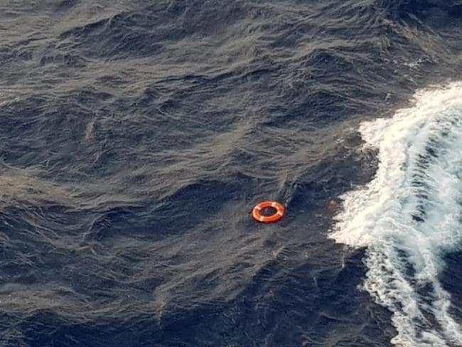 A crew member saw the woman fall off the Pacific Dawn at about 4pm when it was 300km west of Pacific island New Caledonia. One passenger posted an image on Twitter of a life ring floating in the water and said the situation was 'horrendous'. Picture: Twitter/Jonathan Trevithick