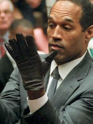 OJ Simpson is seen trying on a pair of gloves during his double homicide trial in 1995. Picture: Supplied