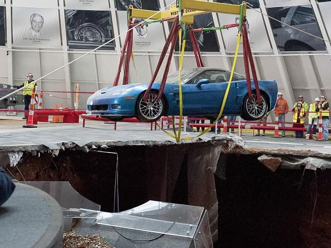 Collapse...One of eight Chevrolet Corvettes is removed from a sinkhole in the Skydome at the US National Corvette Museum in Bowling Green, Kentucky. Picture: AP